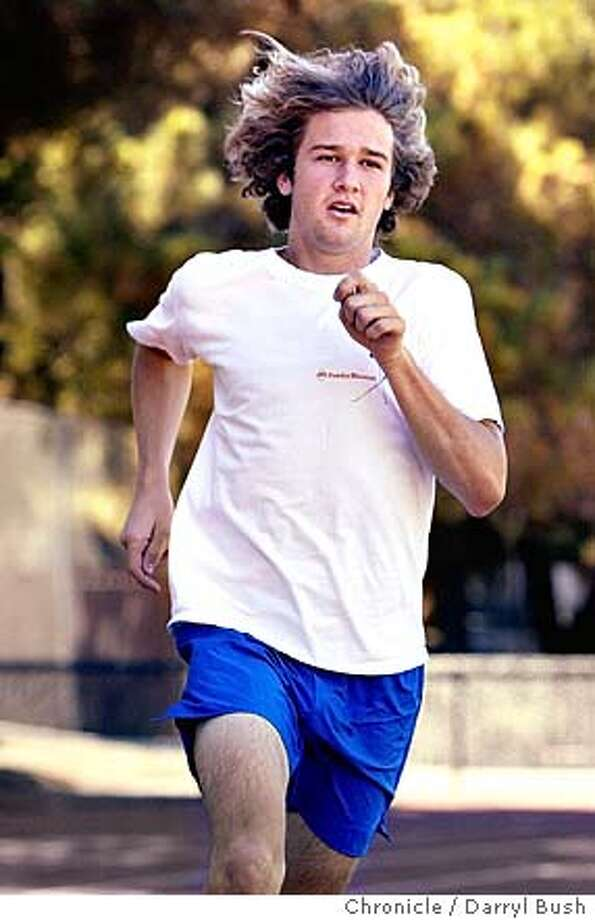 Menlo-Atherton High School cross-country runner Evan Anderson works out near the track. 9/22/04 in Atherton  Darryl Bush / The Chronicle Photo: Darryl Bush