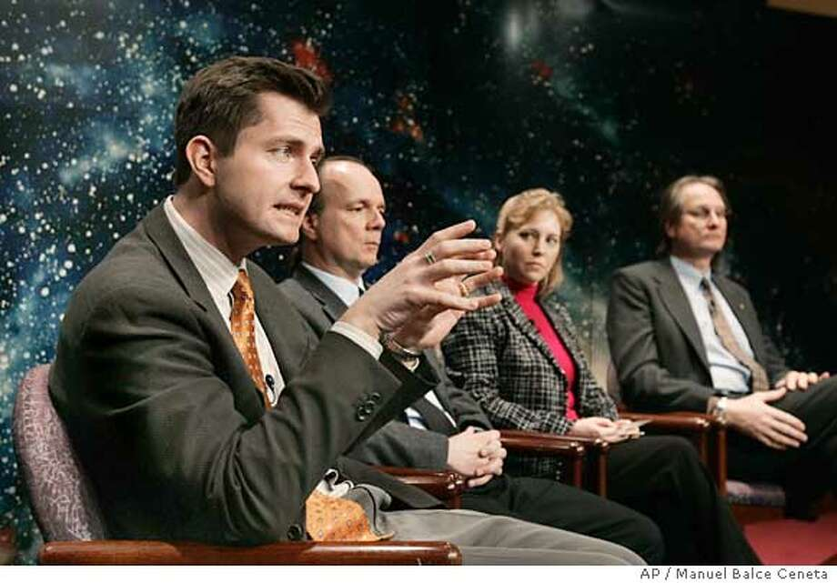 David Charbonneau of Harvard-Smithsonian Center for Astrophysics, Cambridge, Massachusetts, left to right: Drake Deming of NASA's Goddard Space Flight Center, moderator Kim Weaver of NASA's Science Mission Directorate, Washington and Alan Boss of Department of Terrestrial Magnetism, Carnegie Institution of Washington, hold a NASA science update Tuesday, March 22, 2005, in Washington. NASA's Spitzer Space Telescope captured light, from two known planets orbiting stars other than our sun. (AP Photo/Manuel Balce Ceneta) Photo: MANUEL BALCE CENETA