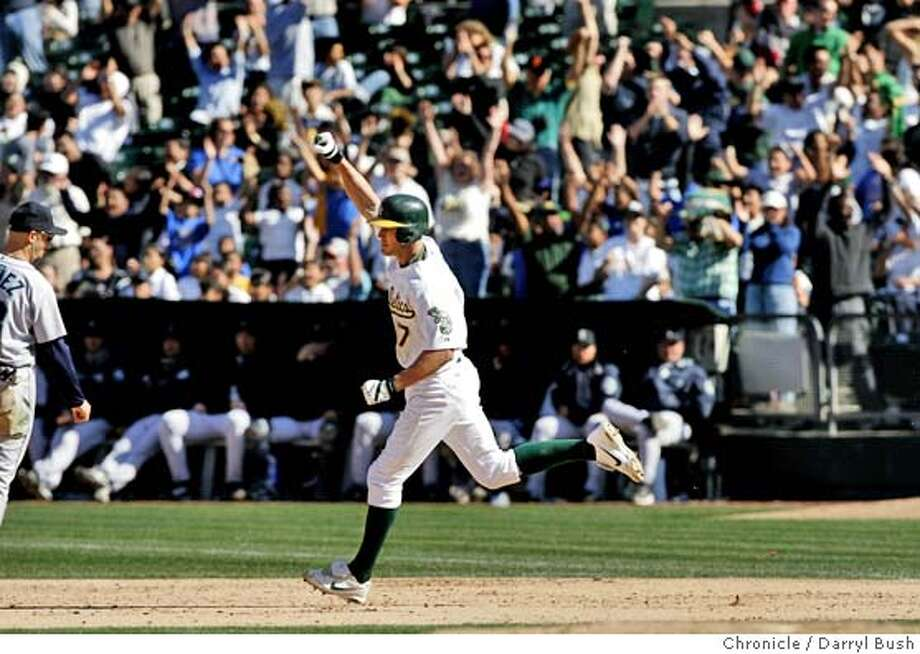 athletics_002_db.jpg  Oakland Athletics Bobby Crosby raises his fist as he rounds the bases after hiting a game winning walk-off home run in the bottom of the ninth inning vs. Seattle Mariners at Oakland. 9/30/04 in Oakland  Darryl Bush / The Chronicle MANDATORY CREDIT FOR PHOTOG AND SF CHRONICLE/ -MAGS OUT Sports#Sports#Chronicle#10/1/2004#ALL#5star##0422385675 Photo: Darryl Bush