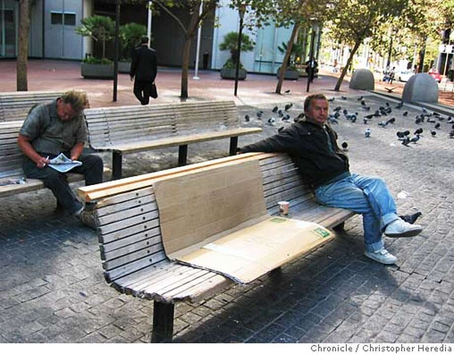 cwbenches01.JPG FOR CHRONWATCH USE ONLY ChronicleWatch looks at dilapidated benches at public plaza at Market and Battery streets. In this series of photos, benches have been fitted with temporary wooden slats. 9/20/04 in San Francisco, CA. Christopher Heredia / The Chronicle Ran on: 09-23-2004 Metro#Metro#Chronicle#10/01/2004#ALL#5star##0422368172 Photo: Christopher Heredia