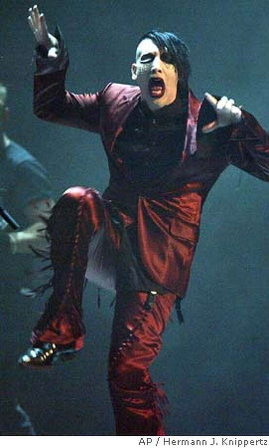 Rock star Marilyn Manson performs at the Koelnarena in Cologne, western Germany, Friday, Sept. 24, 2004, during the entertainment part of the Comet German music award ceremonies. (AP Photo/Hermann J. Knippertz) Datebook#Datebook#Chronicle#10/01/2004#ALL#5star##0422371872 Photo: HERMANN J. KNIPPERTZ