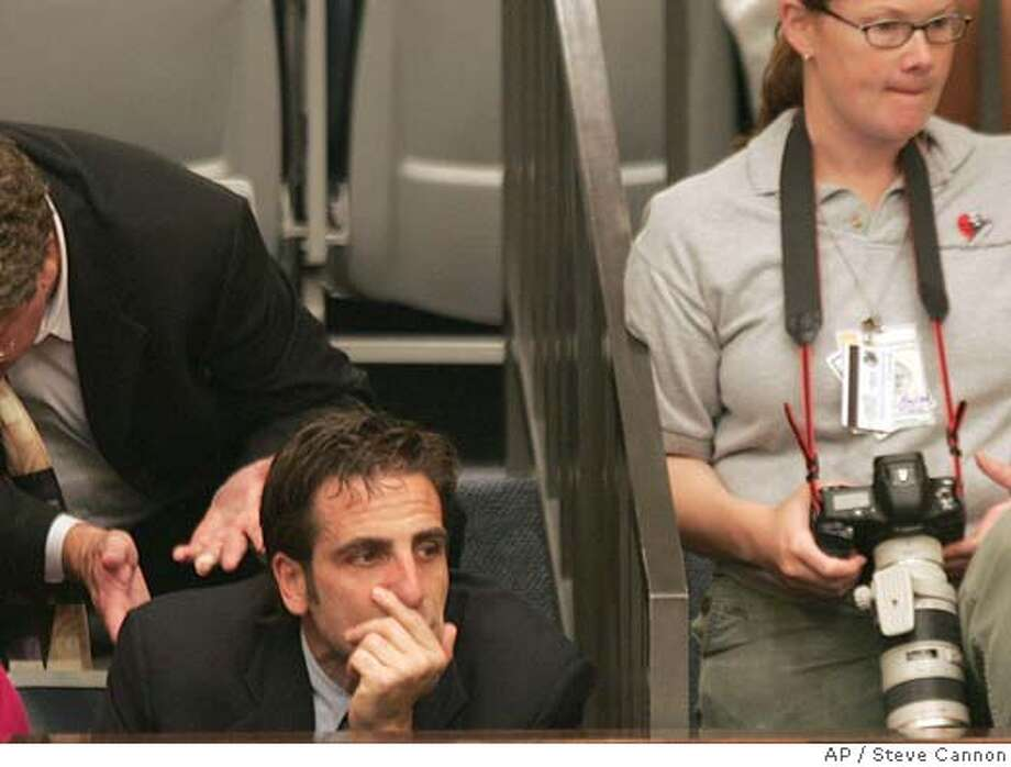 Terri Schiavo's brother, Bobby Schindler listens to the debate on the sustance bill to reinsert Terri's feeding tube in the Senate gallery on Wednesday March 23, 2005 in Tallahassee, Fla. (AP Photo/Steve Cannon) Photo: STEVE CANNON
