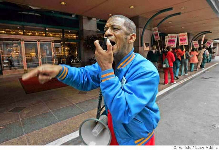 Alphonso Pines of the Local 2 Hotel Employees Union leads the protest chant as customers at the Hilton Hotel arrive in San Francisco, Sept. 29, 2004.  LACY ATKINS/ The Chronicle MANDATORY CREDIT FOR PHOTOG AND SF CHRONICLE/ -MAGS OUT Business#Business#Chronicle#9/30/2004#ALL#5star##0422383384 Photo: LACY ATKINS