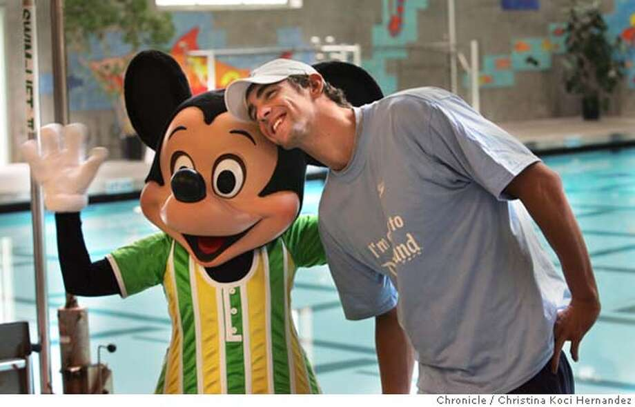 pool01077_ckh.jpg  Michael Phelps shares a moment with Mickey Mouse.Olympic swimmers - including Michael Phelps, Ian Crocker and Lenny Krayzelburg - entertain fifth graders from the new 21st Century College Prep Academy, in the Bayview with a swimming demonstration. The Disney program aims to get kids involved in swimming and athletic competition in general. For pic box.CHRISTINA KOCI HERNANDEZ/CHRONICLE Sports#Sports#Chronicle#10/1/2004#ALL#5star##0422385074 Photo: CHRISTINA KOCI HERNANDEZ