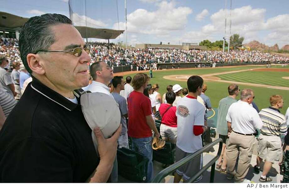 San Jose, Calif. Mayor Ron Gonzales, left, holds his cap during the national anthem prior to a spring training game between the Oakland Athletics and the San Francisco Giants Sunday, March 20, 2005, at Phoenix Municipal stadium in Phoenix. Mayor Gonzales announced today his intention of seeking a major league baseball team to the 'Capital of the Silicon Valley', San Jose, Calif. (AP Photo/Ben Margot) Photo: BEN MARGOT