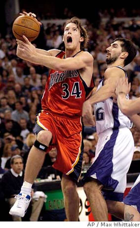 Golden State Warriors forward Mike Dunleavy drives past Sacramento Kings' Peja Stojakovic during the second quarter in Sacramento, Calif. on Sunday, March 20, 2005. (AP Photo/Max Whittaker) Photo: MAX WHITTAKER