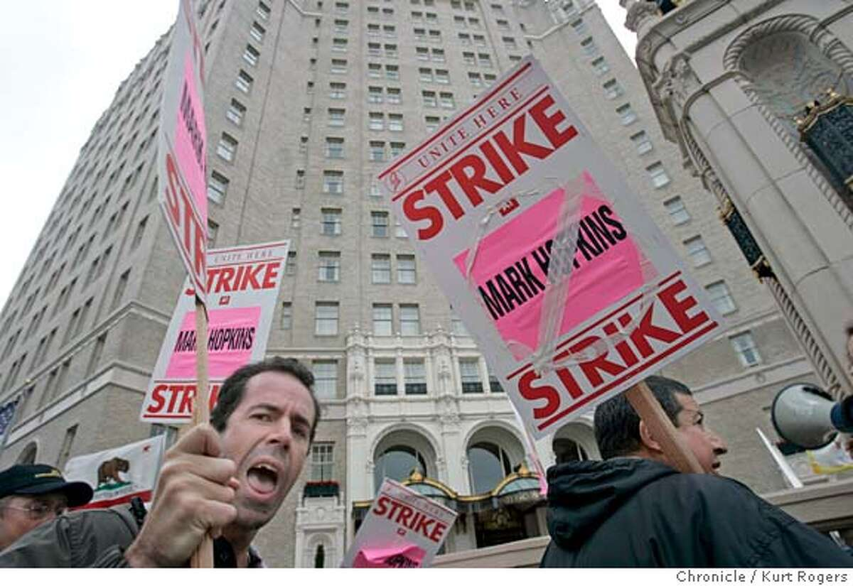 Geoffery Brown (left)who is with the teamsters and works at the Fairmont Hotel. George Lopez (Right) in front of the Mark Hopkins Hotel in San Francisco. The hotel workers union Local 2 Who are on strike. 9/29/04 in San Francisco,CA. KURT ROGERS/THE CHRONICLE