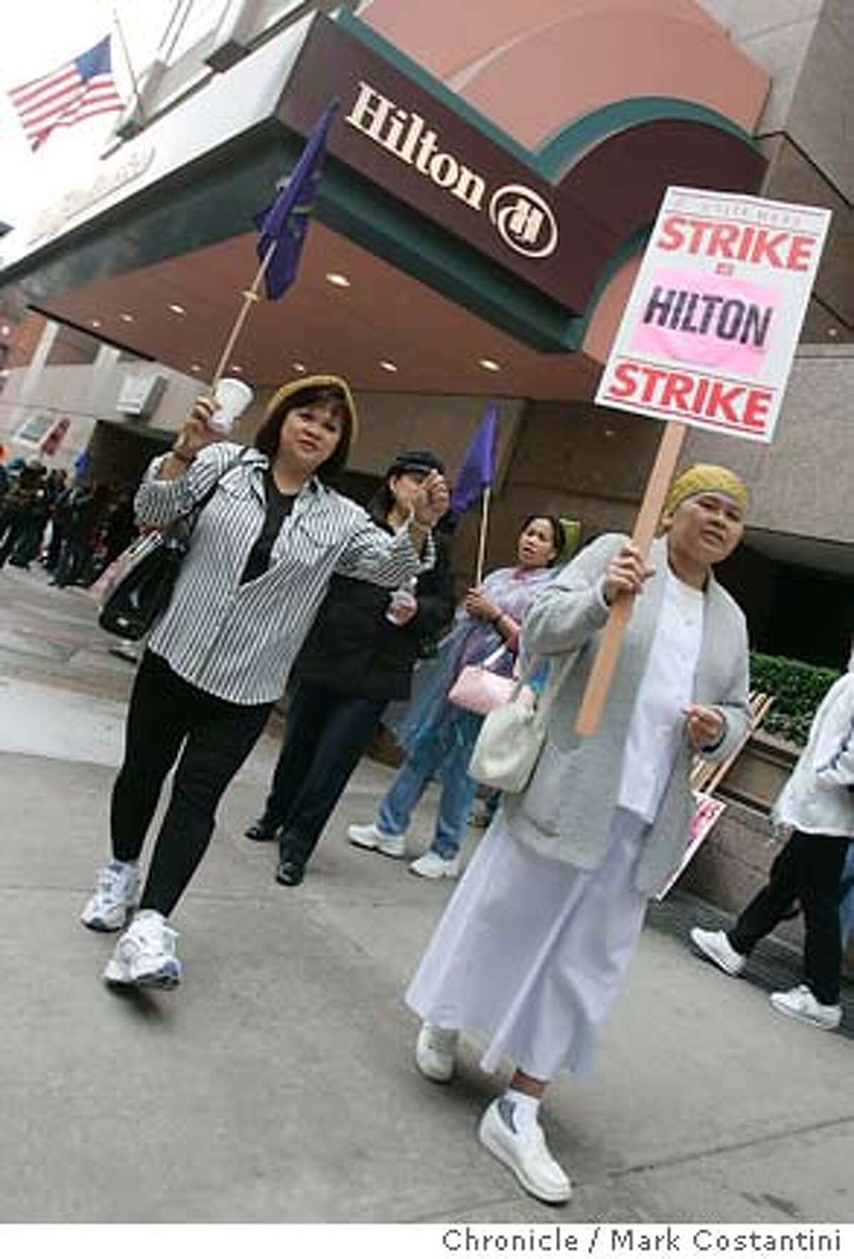 The hotel workers' union, Local 2 of what now is called Unite Here (combination of hotel workers and garment workers) hold a strike at the Hilton Hotel on O'farrell and Taylor--shown here at the strike are Charito Santos(left), who has worked there for 11 years and Fortunata Naua(right), who has worked there for 21 years. Event on 9/28/04 in SAN FRANCISCO Photo: Mark Costantini/S.F. Chronicle