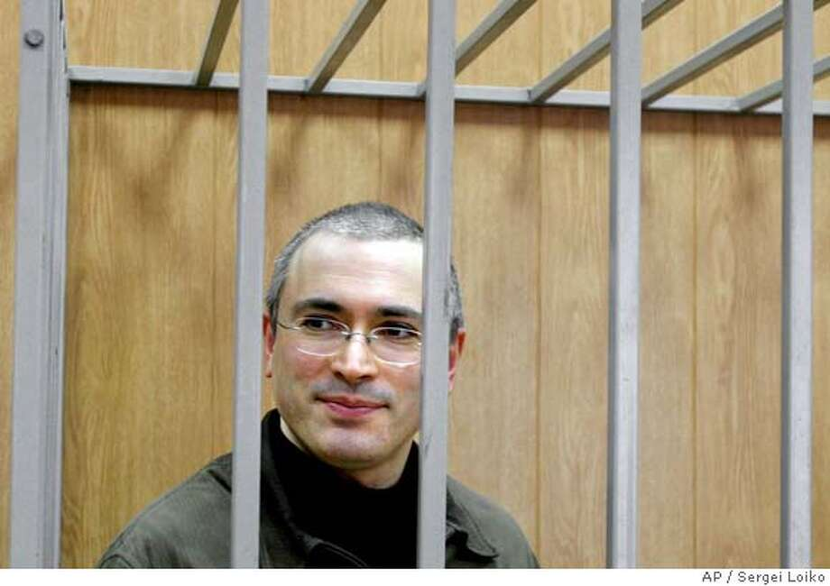 Yukos former CEO Mikhail Khodorkovsky seen in a defendants' cage in a courtroom in Moscow, Monday, Feb. 28, 2005. A lawyer for the jailed ex-CEO of the shattered Yukos oil empire said his client's trial on tax fraud and other charges could end in April. (AP Photo/Sergei Loiko) Photo: SERGEI LOIKO