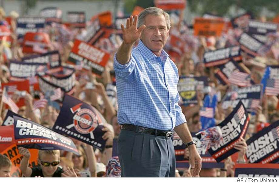 President Bush waves at thousands of supporters at a ralley at the Voice of America in West Chester, Oh., Monday Sept. 27, 2004. (AP PHoto/Tom Uhlman) Photo: TOM UHLMAN -STR