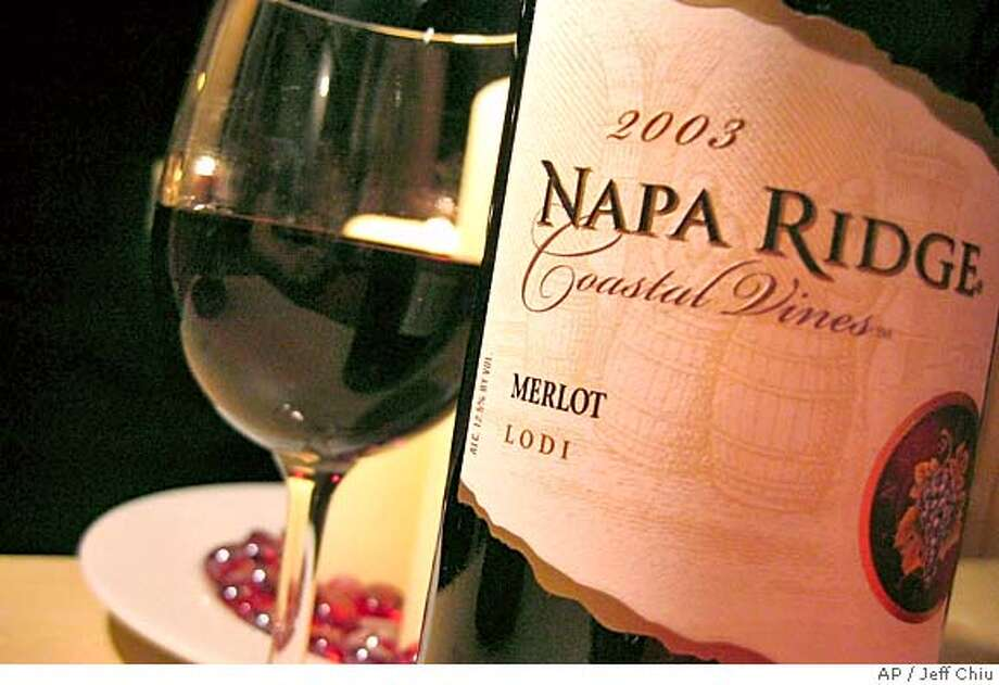 """A bottle of Napa Ridge 2003 Merlot is photographed in San Francisco on Wednesday, Feb. 16, 2005. The Supreme Court declined to intervene, Monday, March 21, 2005, in a dispute over when wine companies can tout the Napa Valley name on their bottles. Without comment, justices let stand a lower court ruling that said wine sold with """"Napa"""" on the label must be made from at least 75 percent Napa-grown grapes. (AP Photo/Jeff Chiu) Photo: JEFF CHIU"""