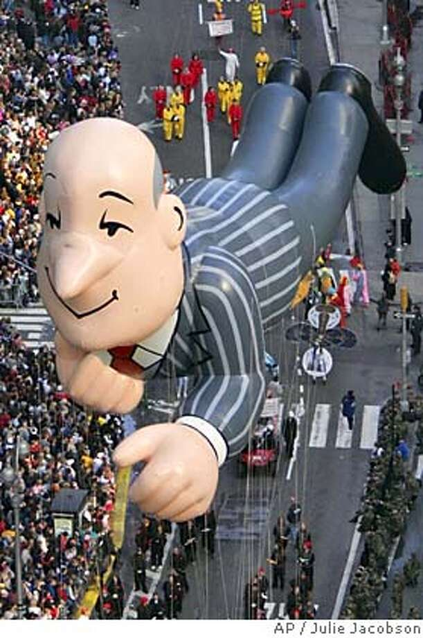 ** FILE ** Ask Jeeves character baloon is paraded down Broadway through Times Square during the 78th Annual Macy's Thanksgiving Day Parade Thursday, Nov. 25, 2004 in New York. Barry Diller's electronic-commerce company IAC/InterActiveCorp is buying Ask Jeeves Inc., the Web-search service, for $1.85 billion, the companies announced Monday, March 21, 2005.(AP Photo/Julie Jacobson) NOV. 25, 2004, PHOTO Photo: JULIE JACOBSON