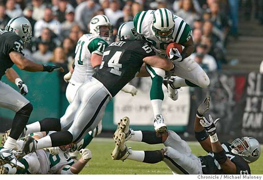 RAIDERSC-C-06JAN02-SP-MM Greg Biekert hits Richie Anderson up high and brings him to the grass in the first quarter. The Oakland Raiders take on the New York Jets on Sunday, January 6, 2002 at Network Associates Coliseum. Michael Maloney/The Chronicle Sports#Sports#Chronicle#9/29/2004#ALL#5star##422124031 Photo: Michael Maloney