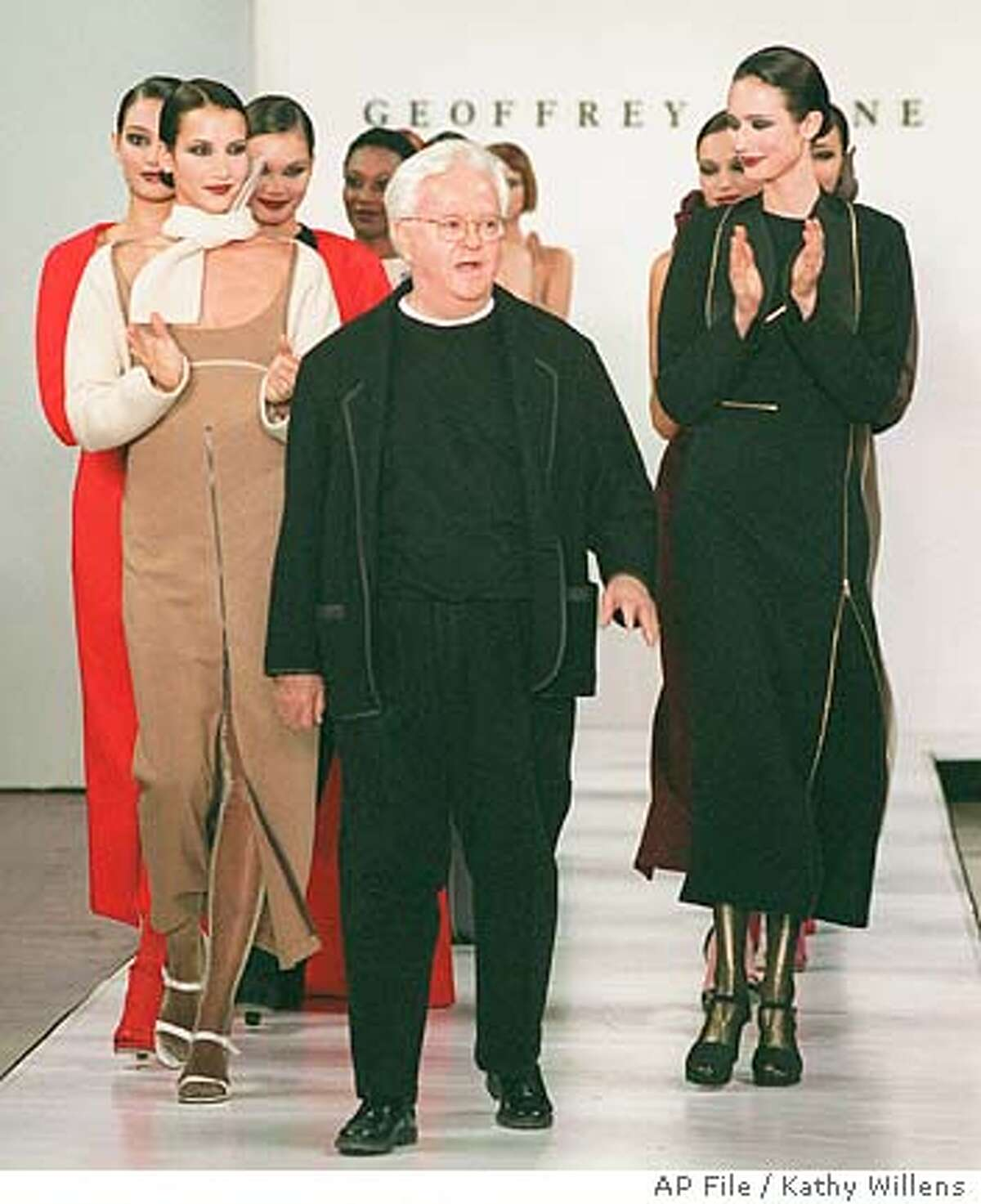 **FILE**Models applaud designer Geoffrey Beene following the presentation of his 1999 fall collection on April 8, 1999, in New York. Beene, the award-winning designer whose simple, classic styles for men and women put him at the forefront of American fashion, died Tuesday, Sept. 28, 2004, at his home. He was 77. Beene died of complications of pneumonia, according to an executive from his company.(AP Photo/Kathy Willens) AN APRIL 8 1999 FILE PHOTO Ran on: 09-29-2004 Fashion models applauded designer Geoffrey Beene after the presentation of his 1999 fall collection in New York City.