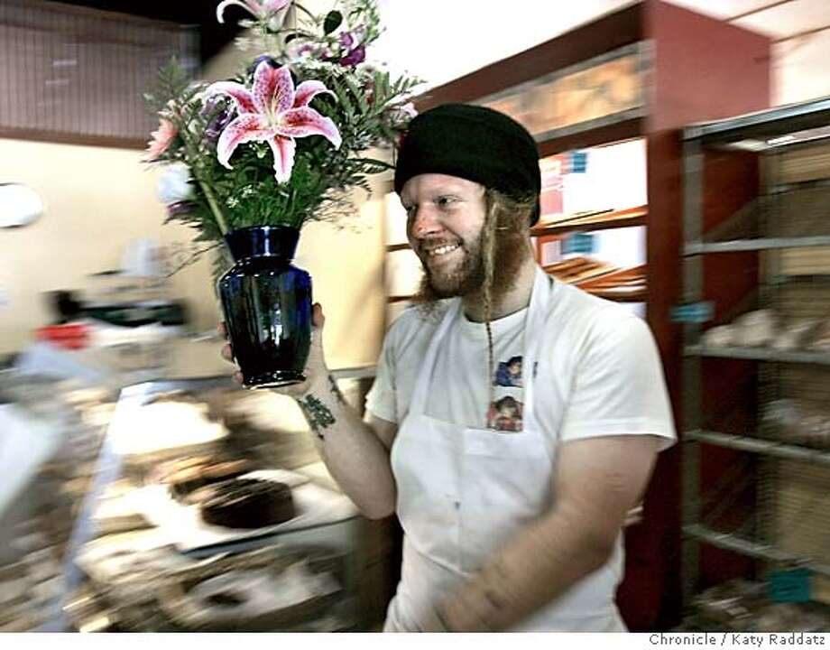 Nabolom Bakery, a worker owned collective in Elmwood, Berkeley, is in financial trouble and in danger of closing. SHOWN: Dylan McPuke (cq) one of the owners/workers has just received a bouquet of flowers for the bakery from a long-time customer, Moira Roth (not shown), who says the bakery is a community center. Katy Raddatz / The Chronicle Photo: Katy Raddatz