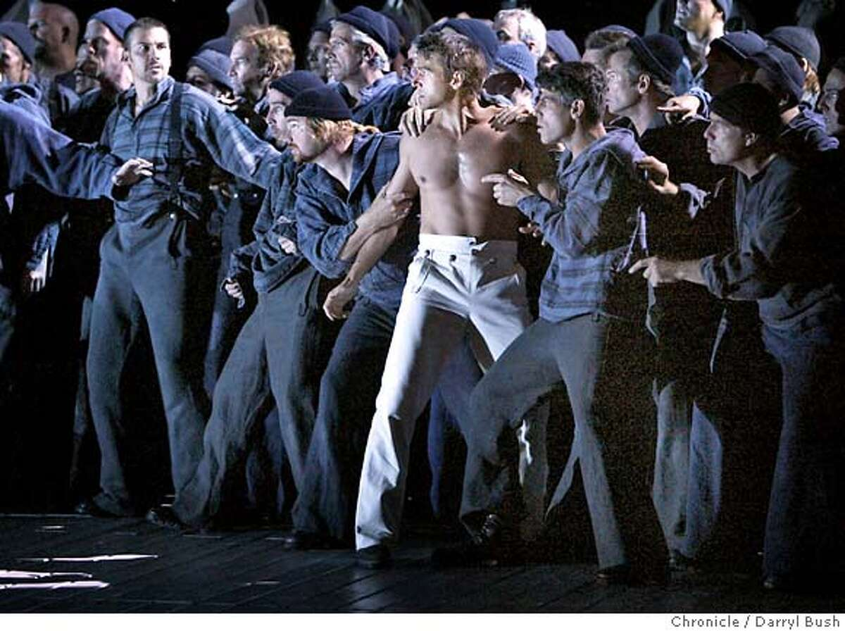"""budd_170_db.jpg Billy Budd (shirtless) played by Nathan Gunn, is surrounded by seamen as he sees Squeak going through his things to spy on him at night in the first act of """"Billy Budd,"""" the opera dress rehearsal by the San Francisco Opera at the War Memorial Opera House. 9/23/04 in San Francisco Darryl Bush / The Chronicle MANDATORY CREDIT FOR PHOTOG AND SF CHRONICLE/ -MAGS OUT Datebook#Datebook#Chronicle#9/28/2004#ALL#5star##0422371007"""