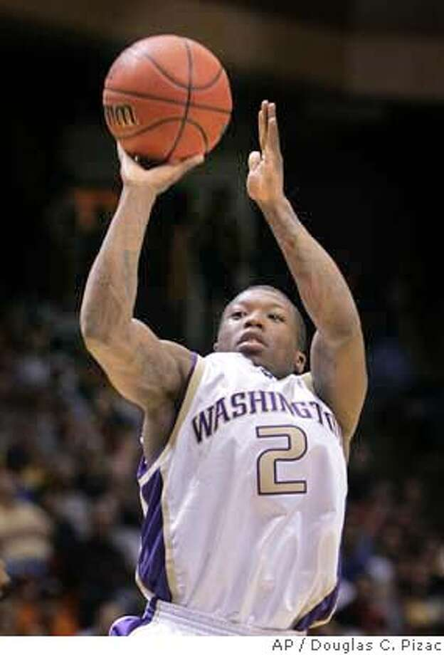 Washington's Nate Robinson shoots against Pacific in the second half of their second round game of the NCAA Tournament in Boise, Idaho, Saturday, March 19, 2005. Robinson scored a team-high 23 points as the Huskies went on to win 97-79. (AP Photo/Douglas C. Pizac) Photo: DOUGLAS C. PIZAC