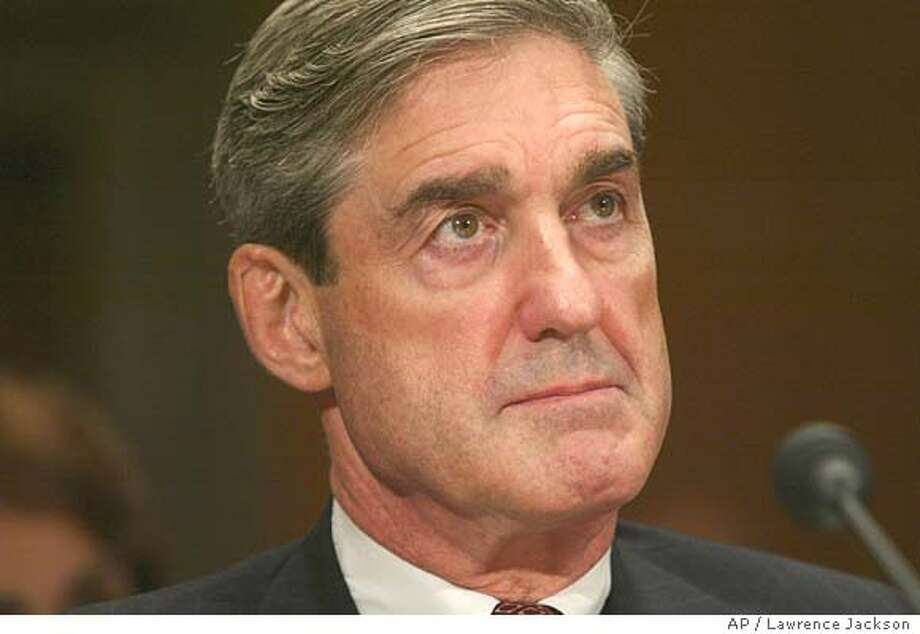** RETRANSMITTING TO CHANGE SLUG TO CONGRESS INTELLIGENCE ** Robert S. Mueller, III, director of the F.B.I., testifies on Capitol Hill before the Senate Committee on Governmental Affairs, Wednesday, Sept. 8, 2004, in Washington.(AP Photo/Lawrence Jackson) ** RETRANSMITTING TO CHANGE SLUG TO CONGRESS INTELLIGENCE ** Nation#MainNews#Chronicle#9/28/2004#ALL#5star##0422333497 Photo: LAWRENCE JACKSON