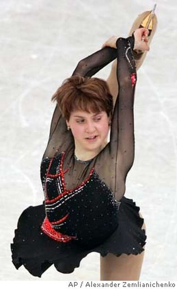 Russia's Irina Slutskaya in action on her way to winning the gold medal at the World Figure Skating Championships in Moscow Saturday March 19, 2005. Slutskaya won the gold medal Saturday at the women's World Figure Skating Championships, capping a season in which she surged despite lingering heart problems. (AP Photo/Alexander Zemlianichenko) Photo: ALEXANDER ZEMLIANICHENKO
