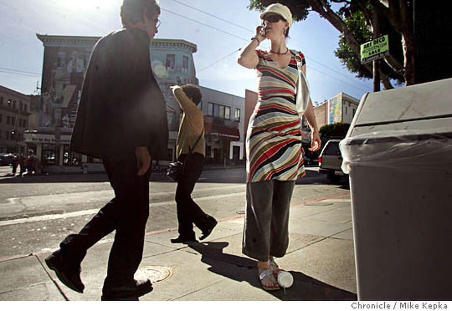 "California Walsh said, ""It blooming out here"" in her BCBG dress over yoga pants with Italian sun glasses.  On Location Columbus and Broadway  Mike Kepka / The Chronicle Photo: Mike Kepka"