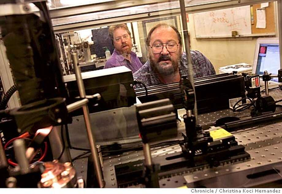 dating27015_ckh.jpg ((background) Becker and (foreground) Renne look through the glass at a mass spectrometer, part of an argon-argon dating system.To photograph (R)Paul Renne,a scientist withfossil-bearing rock who determines how long ago human ancestors lived in Africa.  Also need photo of(L) Tim Becker, laboratory director,either one at one of the complicated machines in the lab,they use to determine the dates by radioactive decay of uranium, argon, etc.  .  CHRISTINA KOCI HERNANDEZ/CHRONICLE Metro#MainNews#Chronicle#9/27/2004#ALL#5star##0422370505 Photo: CHRISTINA KOCI HERNANDEZ