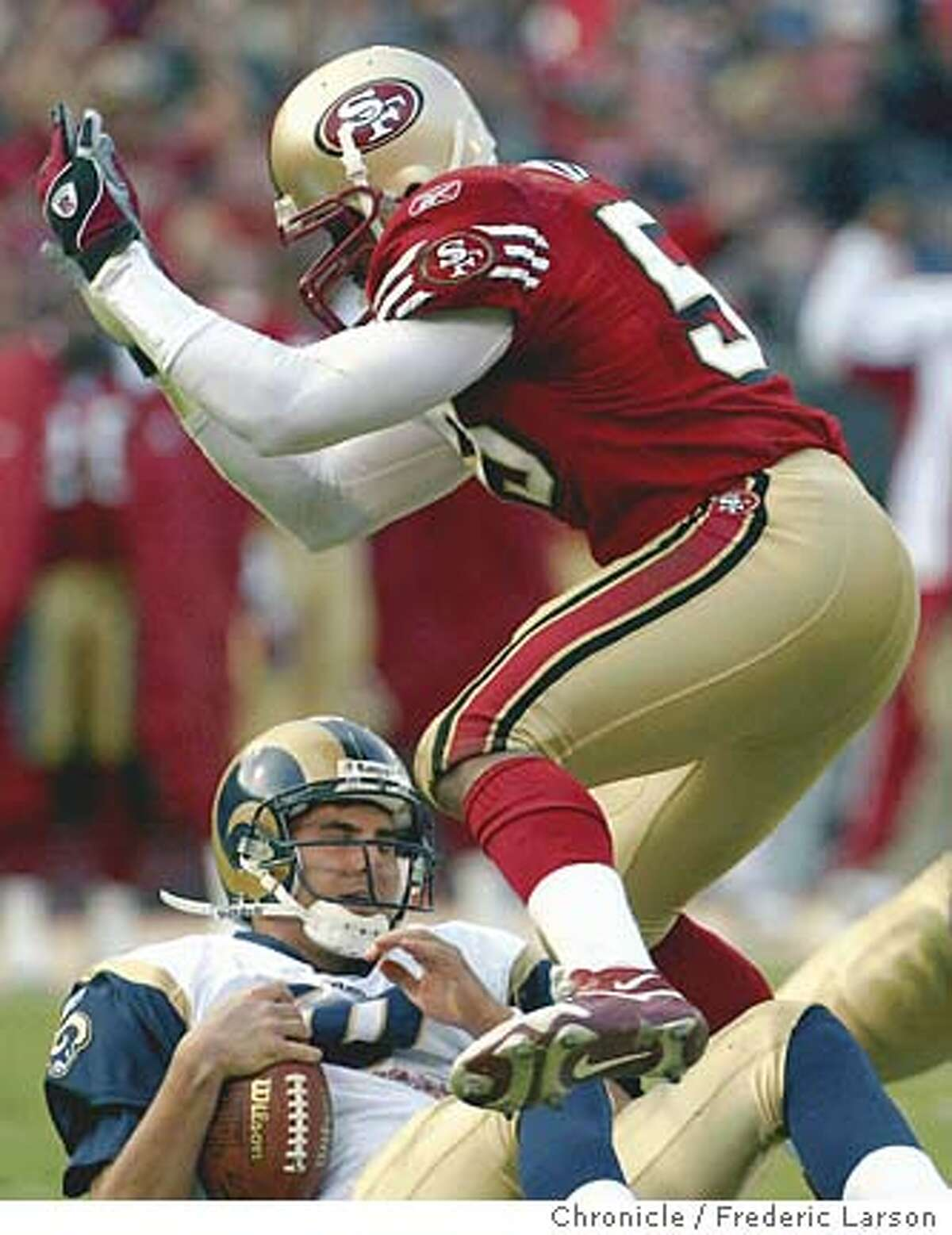 ; 49ers Jamie Winborn sacks Rams QB Marc Bulger in the 4th quarter to stall any comes back drive by the St Louis Rams. San Francisco 49ers beat the St. Louis Rams at Candlestick Park, 30-10. FREDERIC LARSON / The Chronicle