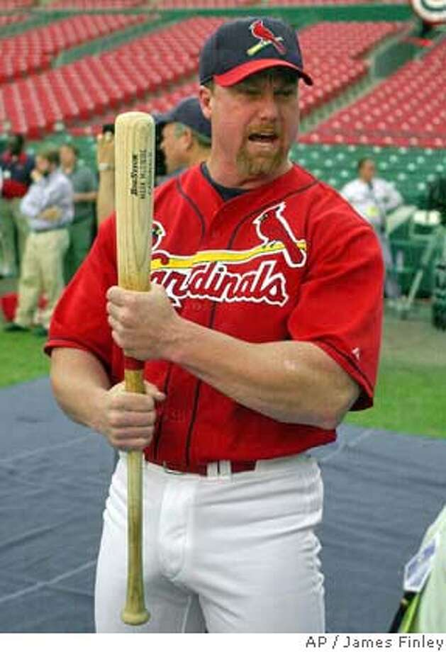 St. Louis Cardinals' Mark McGwire clutches a bat during warmups before Game 2 of the National League Championship Series against the New York Mets at Busch Stadium in St. Louis Thursday, Oct. 12, 2000. (AP Photo/James Finley) Ran on: 03-13-2005  Mark McGwire's reputation may take a blow if he testifies about steroids. Ran on: 03-13-2005  Mark McGwire's reputation may take a blow if he testifies about steroids. Ran on: 03-13-2005  Mark McGwire's reputation may take a blow if he testifies about steroids. DIGITAL IMAGE Photo: JAMES. A. FINLEY