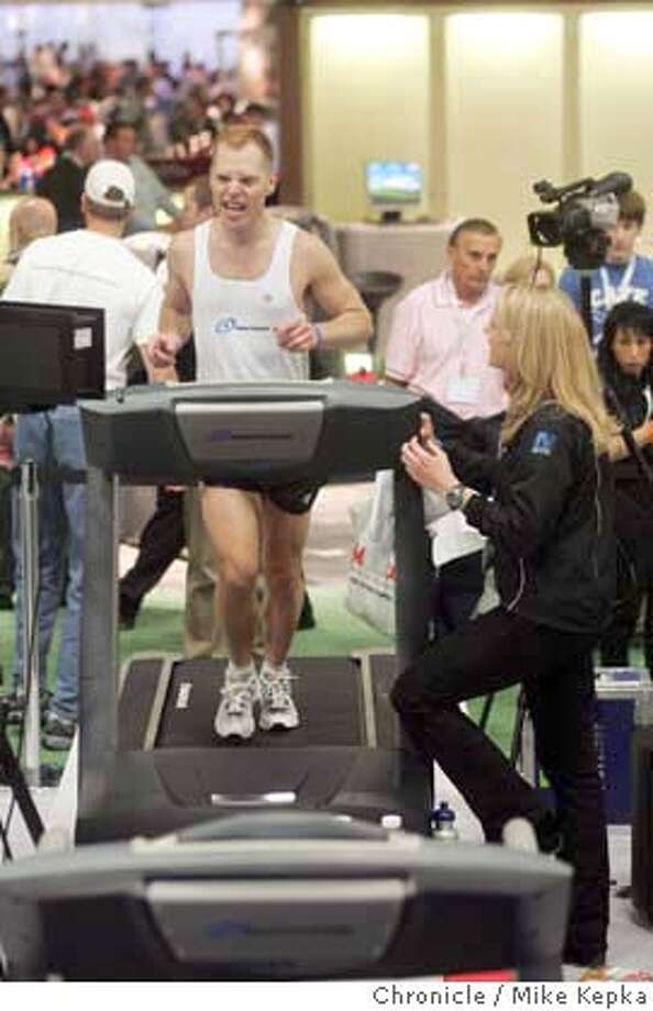 treadmill044_mk.jpg About an hour from running 50 miles on a Nautilus treadmill, Geoff Weber, 37, lets out a burst of energy through his face.  Fitness fanatics from around the world come to Moscone Center for the International Health and Racquet Sportsclub Association.  Mike Kepka / The Chronicle MANDATORY CREDIT FOR PHOTOG AND SF CHRONICLE/ -MAGS OUT Photo: Mike Kepka