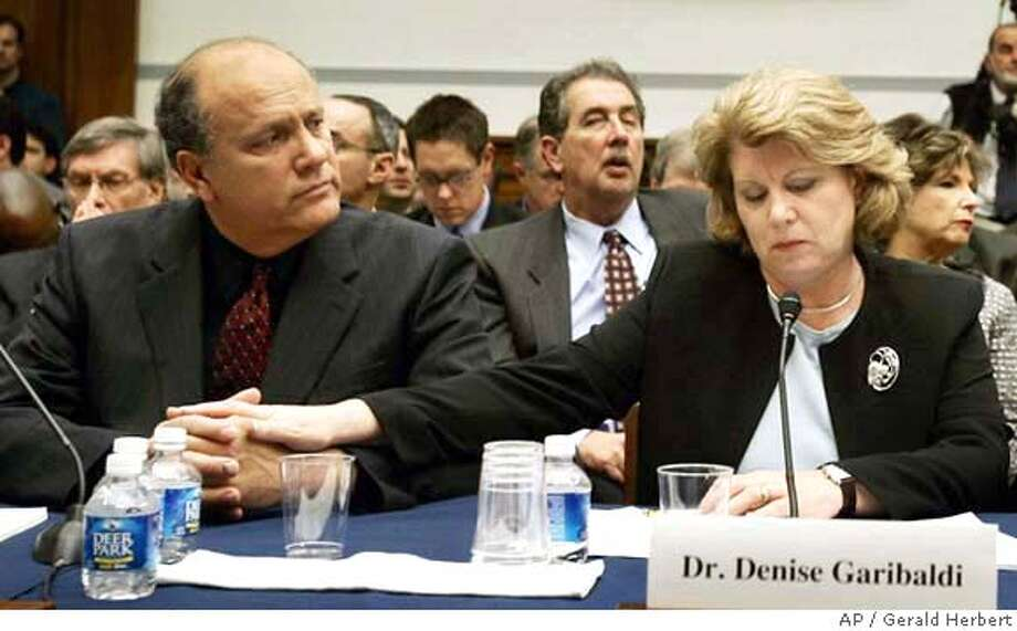Dr. Denise Garibaldi comforts her husband Ray Garibaldi as they listen to testimony during a hearing on Capitol Hill in Washington Thursday, March 17, 2005, on the use of steroids in professional baseball. (AP Photo/Gerald Herbert) Photo: GERALD HERBERT