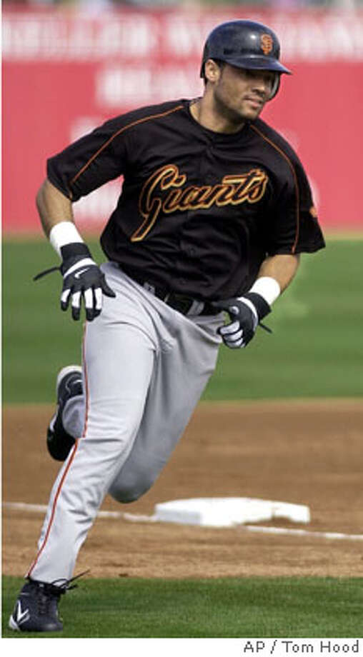 San Francisco Giants' Pedro Feliz rounds third base to score on a base hit by Edgardo Alfonzo against the Los Angeles in Tempe, Ariz., Thursday, March 3, 2005. Feliz started in left field for an injured Barry Bonds. (AP Photo/Tom Hood) Photo: TOM HOOD