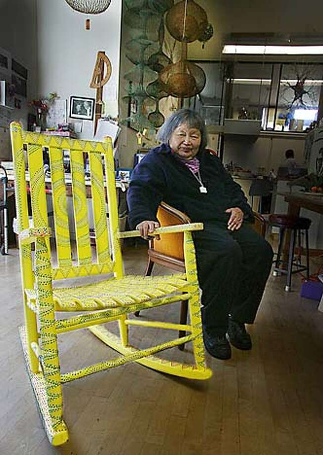 """Artist Ruth Asawa and the rocking chair she painted for the """"Let's Rock and Roll"""" fundraiser for the disabled and elderly to be held in Union Square on Friday, October 1, 2004.  HANDOUT"""