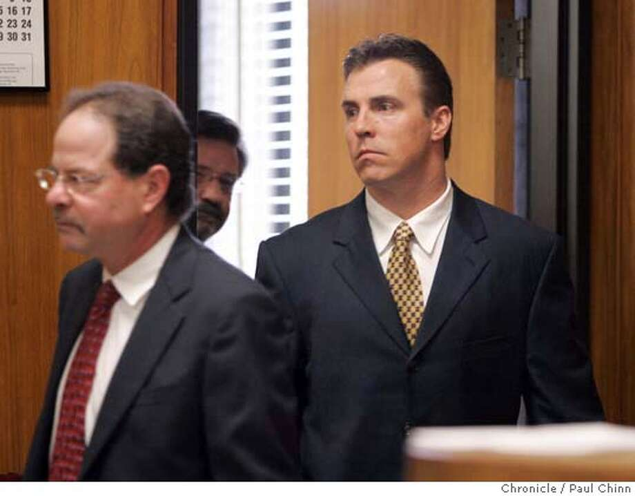 romanowski_036_pc.jpg  Bill Romanowski (right) emerges from a pre-trial meeting in Judge Cecilia Castellanos' chambers. Opening statements in the civil trial against former Oakland Raiders player Bill Romanowski on 3/1/05 in Oakland, CA. Former teammate Marcus Williams filed a $3.8 million lawsuit against Romanowski after a practice field fight severly injured Williams.  PAUL CHINN/The Chronicle Ran on: 03-17-2005  NFL great Jerry Rice (left) and Tony West, attorney for Marcus Williams, arrive outside Alameda County Superior Court. MANDATORY CREDIT FOR PHOTOG AND S.F. CHRONICLE/ - MAGS OUT Photo: PAUL CHINN
