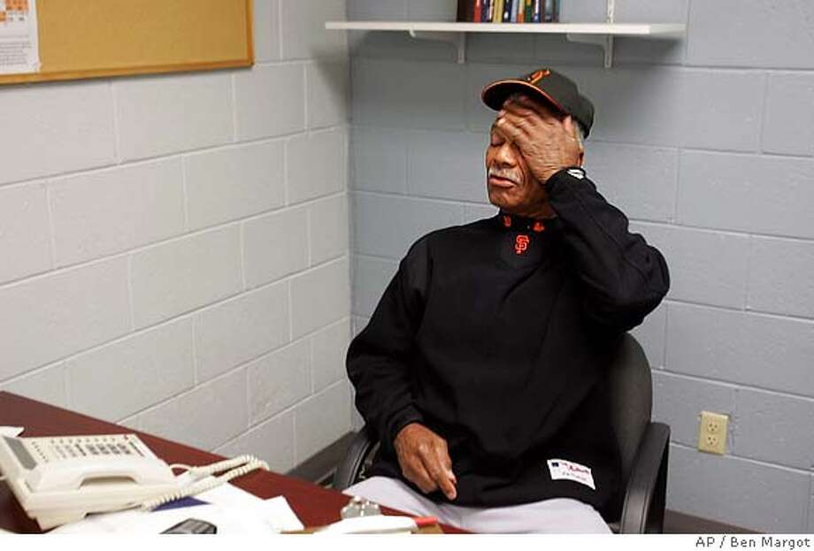 San Francisco Giants' manager Felipe Alou places his hand to his face during a media conference in his Scottsdale Stadium office Thursday, March 17, 2005, in Scottsdale, Ariz. The Giants announced that their star left fielder, Barry Bonds, underwent a second operation on his right knee this morning. (AP Photo/Ben Margot) Photo: BEN MARGOT