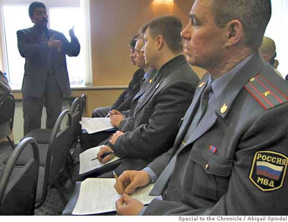 SFPD Inspector Perucci (SP?) speaks to group of Russian police about community policing as part of Climate of Trust seminar. Photo by Abigail Spindel/Special to The Chronicle 3/11/05 NOVGOROD, RUSSIA Photo: Abigail Spindel/Special To The C