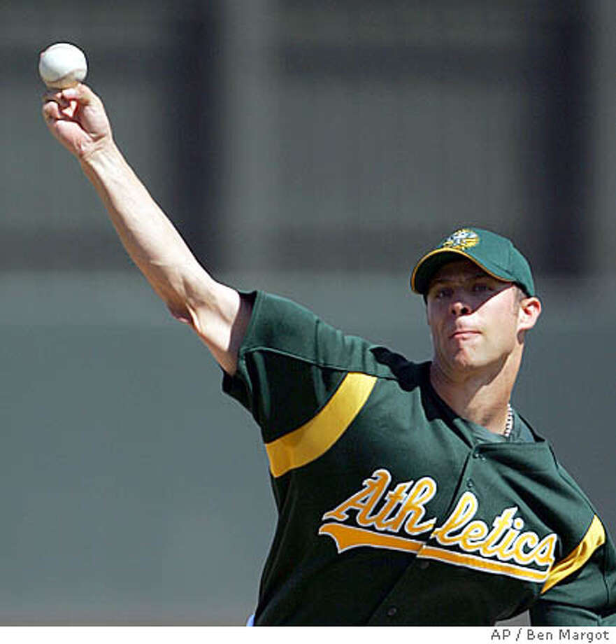 Oakland Athletics' Rich Harden releases a pitch against the Chicago Cubs in the first inning of a spring training game Thursday, March 17, 2005, in Phoenix. (AP Photo/Ben Margot) Photo: BEN MARGOT