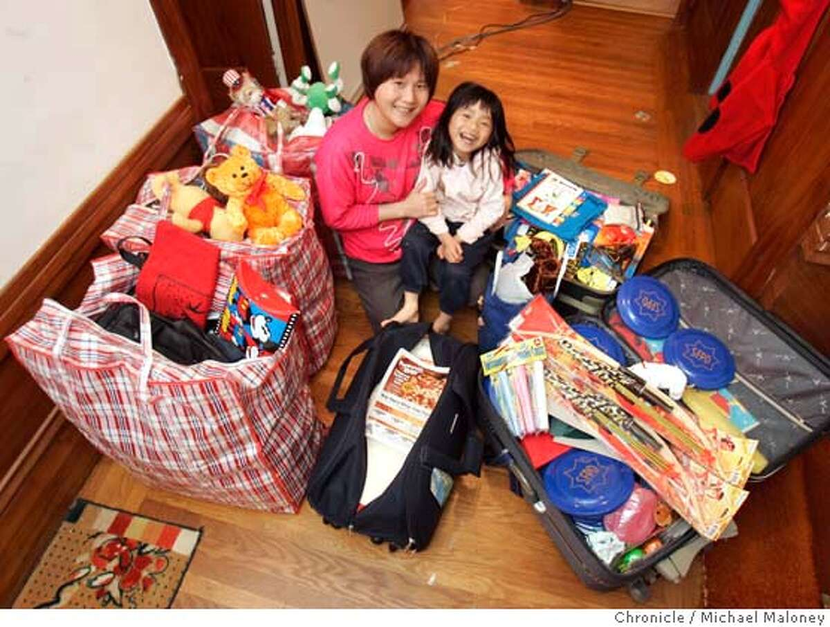 ZHAO_003_MJM.jpg Ellen Zhao and her 5 year old daughter Jodie with suitcases full of donations they plan to take back to a small village in China where she once lived. Zhao, of San Francisco left school in the 5th grade in China. Her mother told her she had no more need for an education since she would only get married and have kids. She worked in her family fields, and in a factory. At 16, she moved here and earned a master's in social work. Now she's going back to the school she was forced to leave, with books, toys, clothes, and tuition raised from co-workers and police officers. All is possible, she wants to tell them. Photo by Michael Maloney / San Francisco Chronicle MANDATORY CREDIT FOR PHOTOG AND SF CHRONICLE/ -MAGS OUT