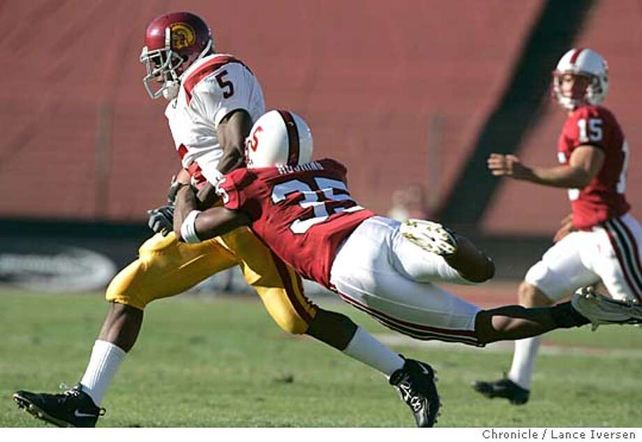 STANFORD0179_LIA.JPG Ucs's #5 Reggie Bush gained 95 yards on the day. 's #35 T.J. Rushing tryed to pop the ball out on this tackle on a kick-off in the first half. CARDINAL VS. USC TROJANS at . By Lance Iversen/San Francisco Chronicle Photo: Lance Iversen