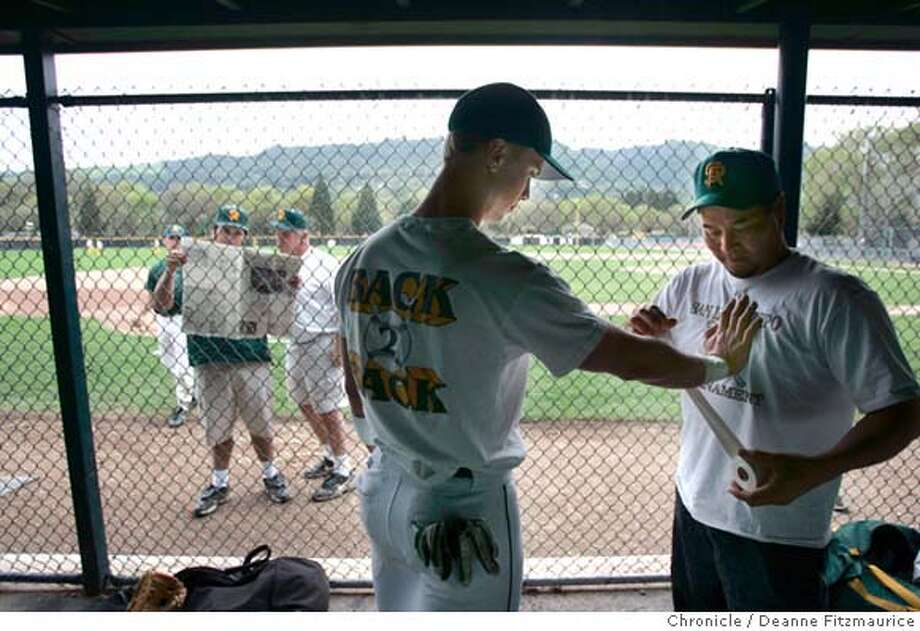 steroids_054_df.JPG  James Darnell gets his wrist taped up by coach Kevin Kim. In the background, coaches are looking at the sports section of the newspaper. San Ramon Valley High School baseball team takes practice and talks about the Congessional hearings about steroids.  Deanne Fitzmaurice / The Chronicle Photo: Deanne Fitzmaurice