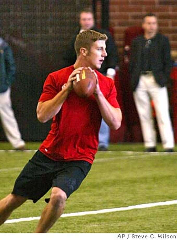 Utah quarterback Alex throws for NFL scouts and coaches during a workout at the school's training facility Wednesday, March 16, 2005, in Salt Lake City. is considered a top pick for this year's NFL draft. (AP Photo/Steve C. Wilson) STAND ALONE PHOTO Photo: STEVE C WILSON