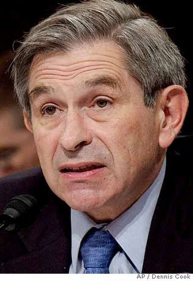 ** FILE ** Deputy Defense Secretary Paul Wolfowitz discusses the Pentagon's contingency reserve fund for the war in Iraq during an appearance before the Senate Armed Services Committee on Capitol Hill Thursday, May 13, 2004. President Bush will recommend that Wolfowitz take over as head of the World Bank, a senior administration official said Wednesday, March 16, 2005. (AP Photo/Dennis Cook) Photo: DENNIS COOK