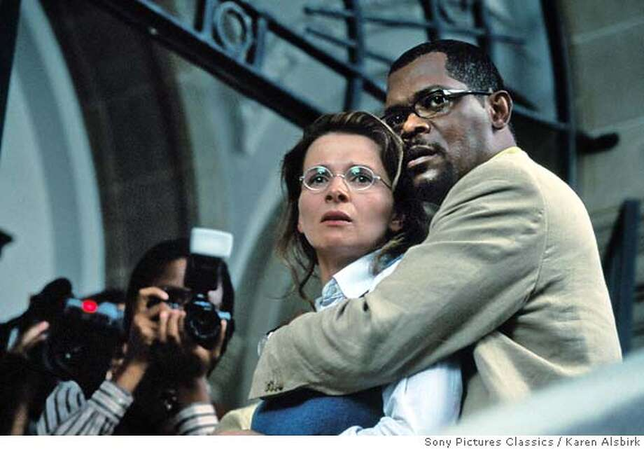 "In this photo provided by Sony Pictures Classics, romance blossoms in the late 1990s between a married American Washington Post journalist Langston Whitfield (Samuel L. Jackson) and an Afrikaner poet/radio journalist Anna Malan (Juliette Binoche) who meet while covering the proceedings of South Africa's Truth and Reconciliation Commission, in ""In My Country."" (Sony Pictures Classics/Karen Alsbirk) Photo: KAREN ALSBIRK"