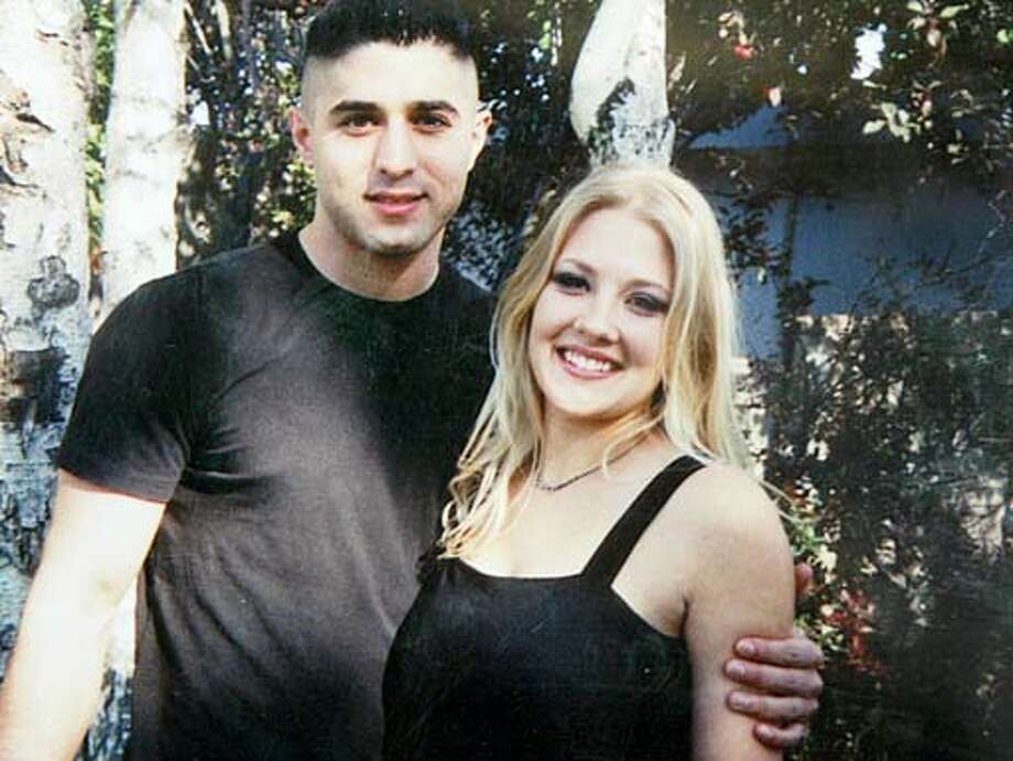 FUNERAL070_MJM.jpg  A family photo of Holly Patterson and her boyfriend Ehsan Bashi (cq).  Funeral of Holly Patterson, an 18 year old woman who died days after taking the abortion pill, RU-486. Services and funeral took place at Callaghan Mortuary and Memory Gardens Cemetery in Livermore.  Event on 9/24/03 in Livermore.  MICHAEL MALONEY / The Chronicle MANDATORY CREDIT FOR PHOTOG AND SF CHRONICLE/ -MAGS OUT Metro#Metro#Chronicle#9/26/2004#ALL#5star#b1#0421407330 Photo: MICHAEL MALONEY