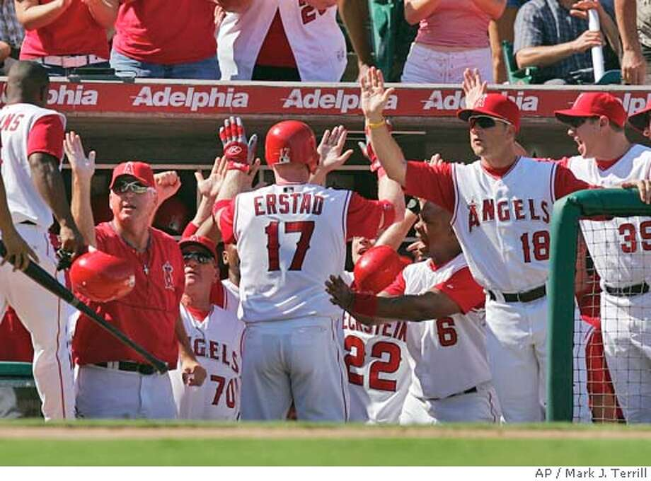 Anaheim Angels' Darin Erstad is cngratulated by teammates after hitting a three-run home run in the fith inning against the Oakland Athletics, Saturday, Sept. 25, 2004, in Anaheim, Calif. The Angels won the game 5-3. (AP Photo/Mark J. Terrill) Sports#Sports#Chronicle#9/26/2004#ALL#5star##0422373921 Photo: MARK J. TERRILL