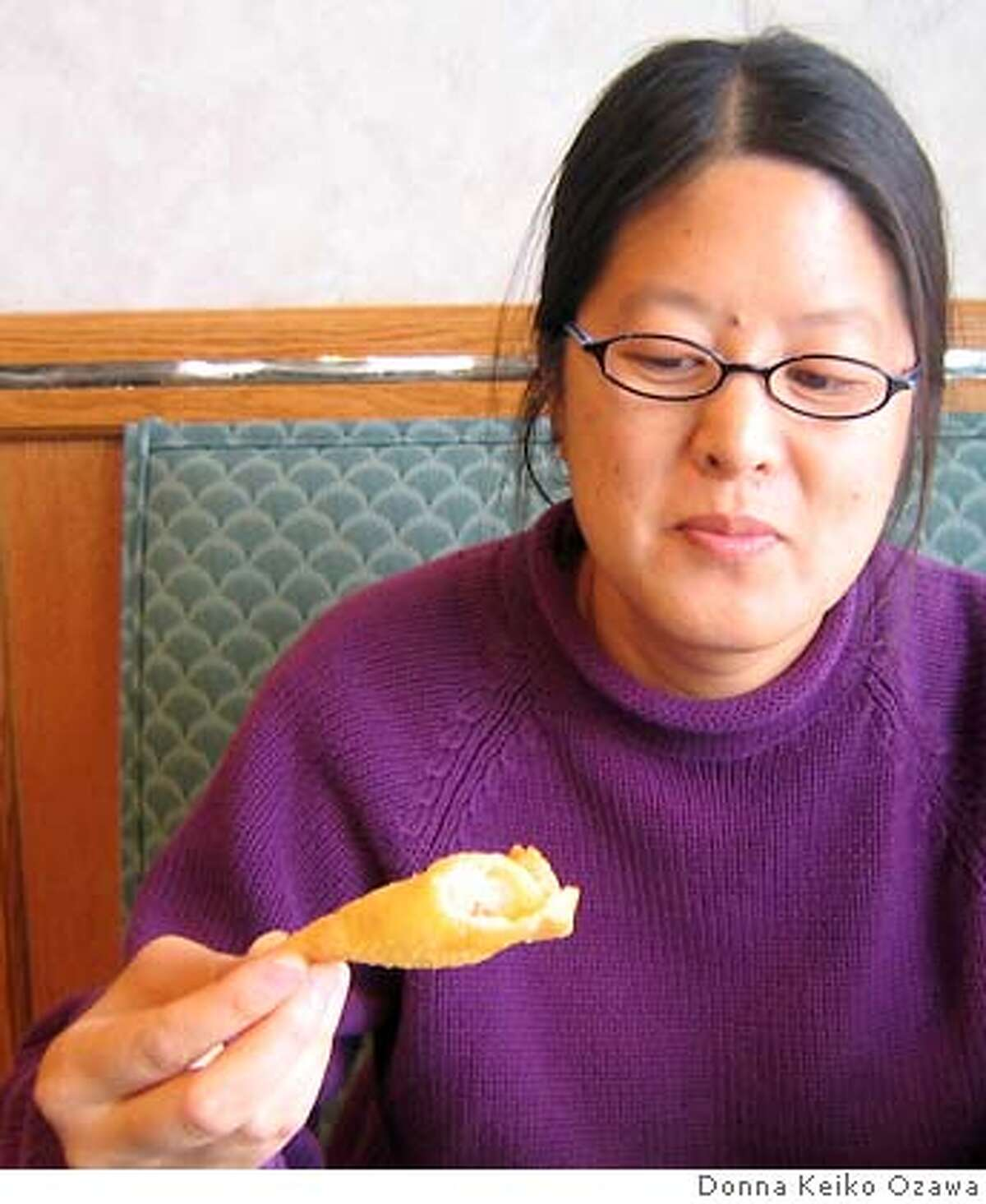 Somewhere in Alabama, Indigo Som looks askance at a crab rangoon. Photo by Donna Keiko Ozawa