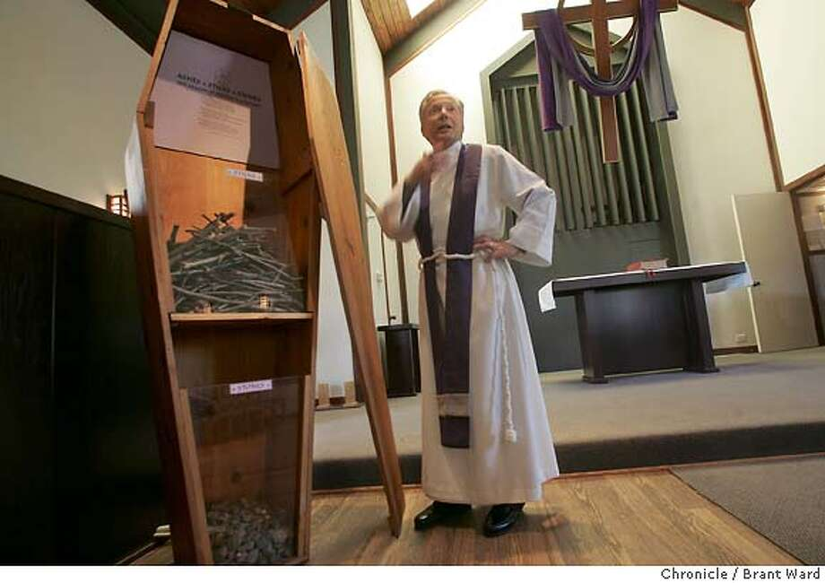 The Rev. John W. Bennison with the coffin he built years ago...he now places it near the altar of his church where it is being filled with sticks and stones.  The antiwar movement as the second anniversary of the U.S. invasion of Iraq arrives. The Rev. John W. Bennison, Rector of St. John's Episcopal in Clayton has put a coffin which parishioners can fill with sticks and stones as their way of silent protest.  Brant Ward 3/14/05 Photo: Brant Ward