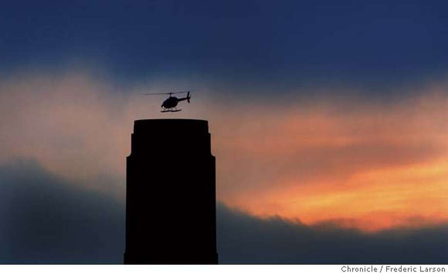 SANFRANSITES084_fl.jpg A helicopter clears Coit Tower at sunrise over San Francisco. 3/16/05 San Francisco CA Frederic Larson The San Francisco Chronicle Photo: Frederic Larson