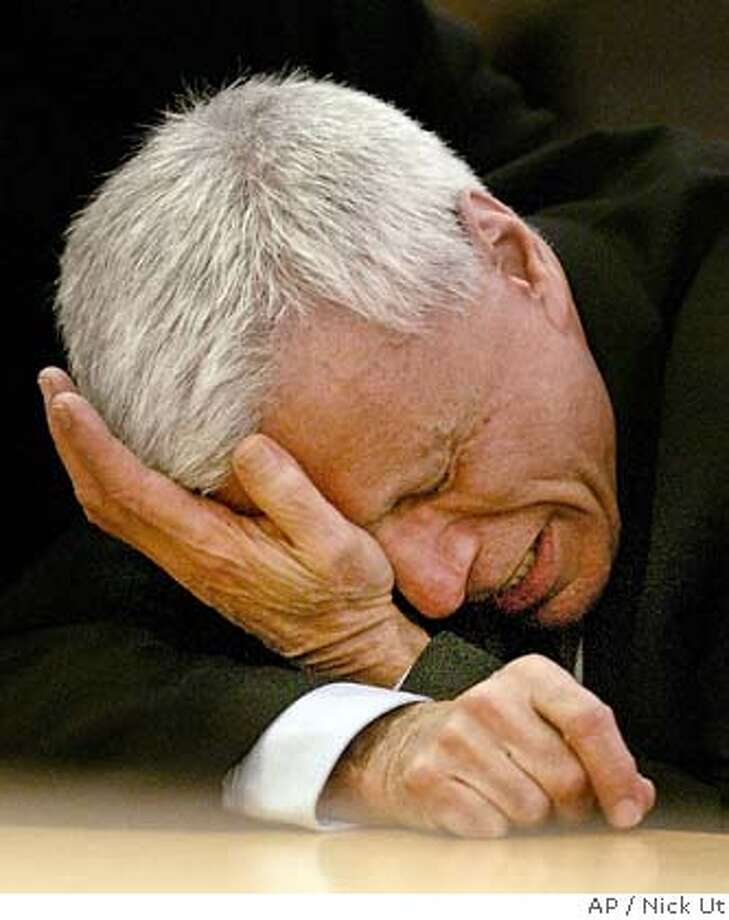 ** CAPTION CORRECTION, CORRECTS ACQUITTAL ON ALL COUNTS TO CLARIFICATION OF VERDICTS ** Robert Blake wipes his eyes after hearing the verdicts in his murder trial for the death of his wife Bonny Lee Bakley in Los Angeles Wednesday, March 16, 2005.A jury acquitted Blake of murder in the shooting death of his wife four years ago, bringing a stunning end to a case that played out like pulp fiction. The jury also acquitted Blake of one charge of trying to get someone to kill his wife, but deadlocked on a second solicitation charge. The jury voted 11-1 in favor of acquittal and the judge dismissed the count. (AP Photo/Nick Ut) RETRANSMITTED FOR IMPROVED TONING Photo: NICK UT