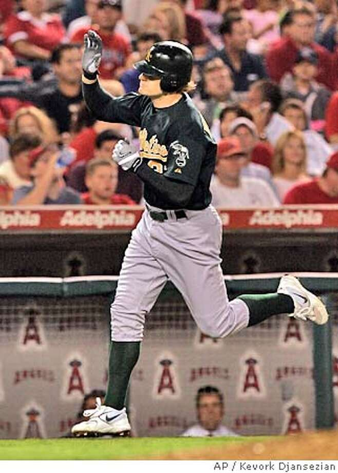 Oakland Athletic's Eric Byrnes celebartes his two-run home run off Anaheim Angels' pitcher Kelvim Escobar during the fourth inning Friday, Sept. 24, 2004, in Anaheim, Calif. (AP Photo/Kevork Djansezian) Photo: KEVORK DJANSEZIAN