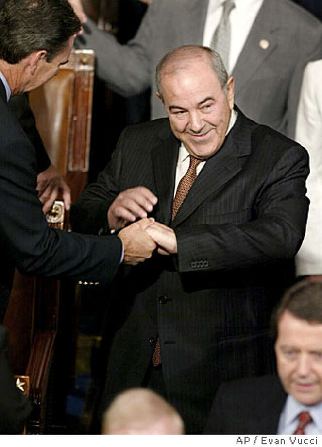 Iraqi Interim Prime Minister Ayad Allawi arrives in the House Chamber to address a joint session of Congress on Thursday, Sept. 23, 2004 in Washington. (AP Photo/Evan Vucci) Photo: EVAN VUCCI