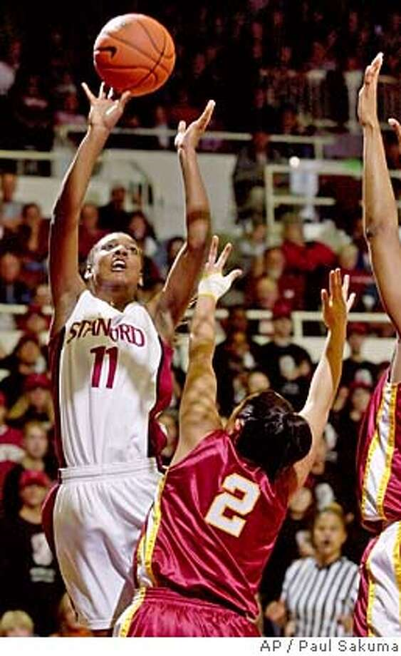 Stanford guard Candice Wiggins scores over Southern Cal point guard Jamie Hagiya (2) in the first half of Pac-10 action, Saturday, Jan. 22, 2005 in Stanford, Calif. Wiggins scored 20 points in the first half. (AP Photo/Paul Sakuma) Ran on: 01-23-2005  Freshman guard Candice Wiggins, who led Stanford with 23 points, puts in a basket over USC guard Jamie Hagiya. Ran on: 01-23-2005  Freshman guard Candice Wiggins, who led Stanford with 23 points, puts in a basket over USC guard Jamie Hagiya. Photo: PAUL SAKUMA